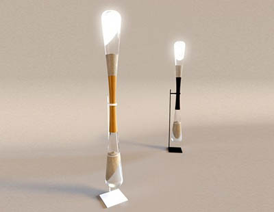 Песочные часы-светильник, который излучает свет от энергии сыплющегося песка